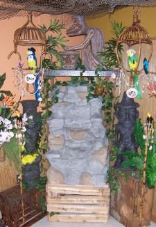 Fountain, tikis and tiki birds in a corner of the Kona Luanii