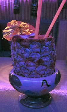 A piña colada in a frozen pineapple