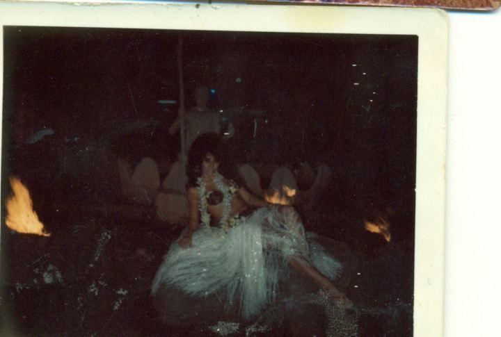 Eva with a tiki, circa 1964