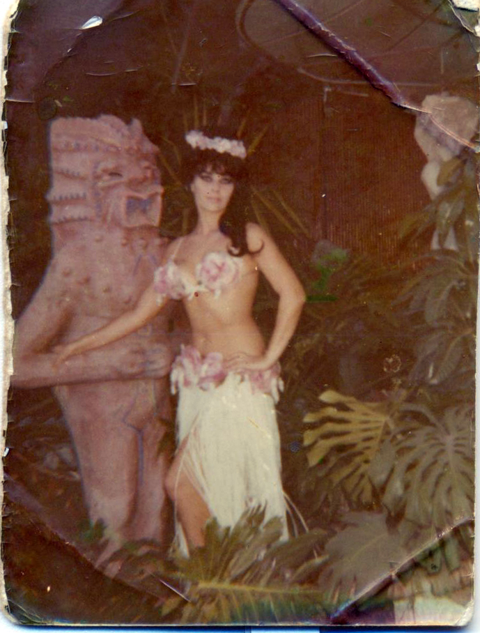 Eva with a tiki, circa 1964