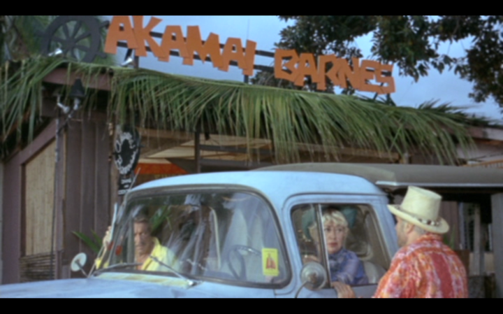 The front of the tiki bar, Akamai Barnes. Reminds me a bit of the sign for Aloha Jhoe's in Palm Springs (which was created by acclaimed Hollywood set designer Lyle Wheeler, who I'm sure had nothing at all to do with this movie).