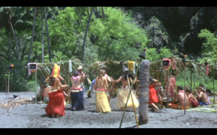 Getting closer to that tiki now. Yes, that hula dancer has a bag on her head. No, it doesn't make any more sense when you're watching the movie.