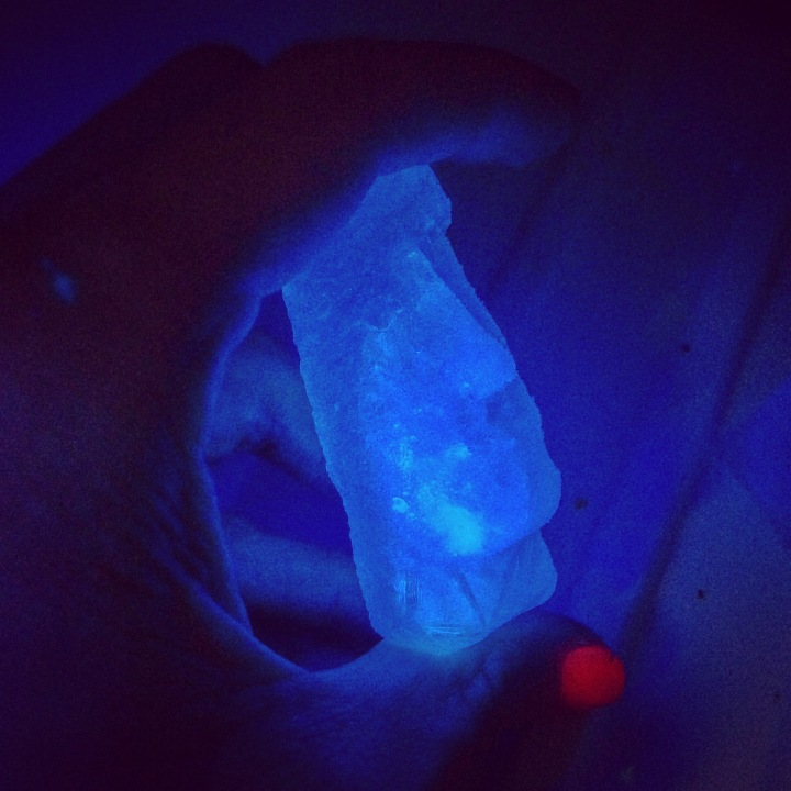 Glowing moai ice cube made with tonic water