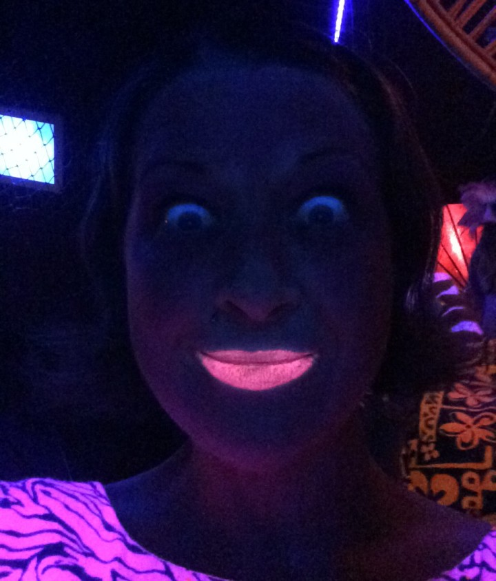 Melissa wore UV reactive lipstick
