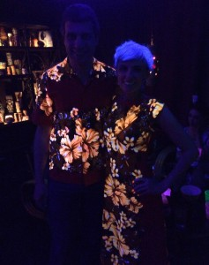 My husband and me in our matching blacklight aloha