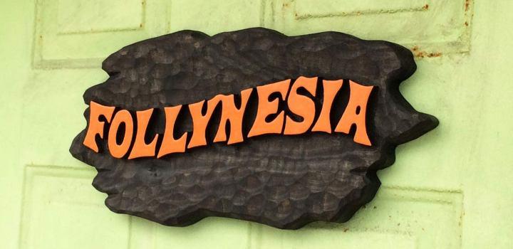 Follynesia sign carved by Lake Tiki