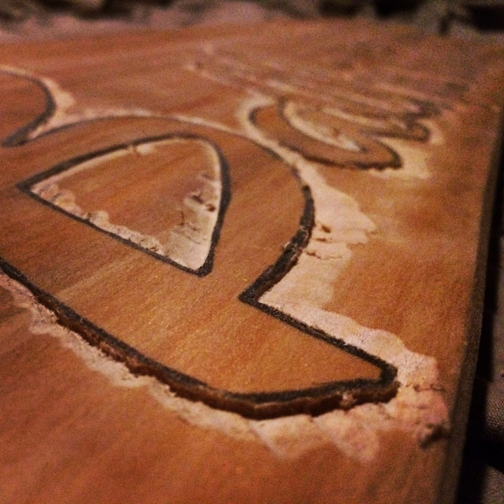 Carve the edge around the design with a Dremel.