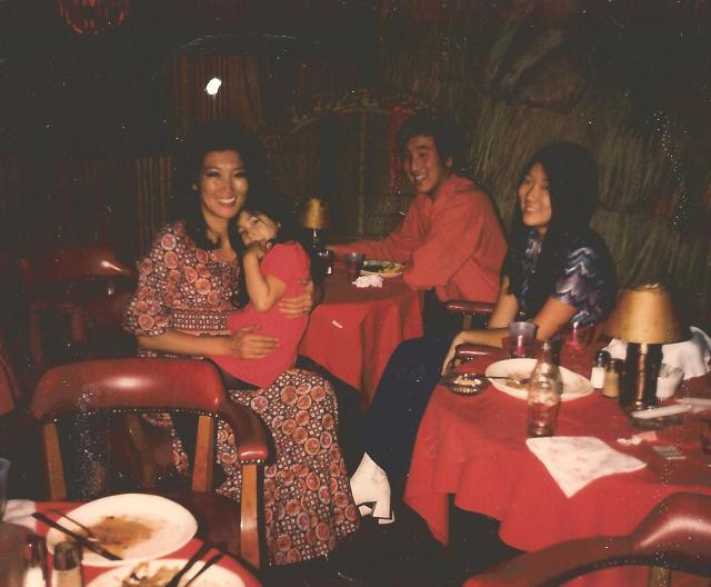 Moon Kim, owner of Luau Hut, with her children at the Capitol Hill location, shared by her daughter